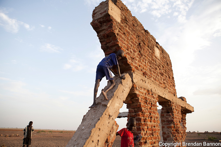 Evening amidst the ruins of a building near an old army settlement in Nasir, South Sudan.