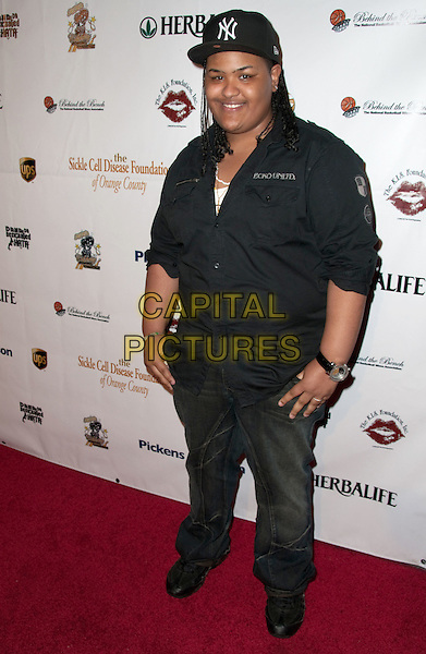 LADY G.K.I.S. Foundation celebrates the 100th discovery year of Sickle Cell Disease with their Annual Bowling Challenge held at PINZ Entertainment  Center, Studio City, CA, USA..September 17th, 2010.full length black shirt jeans denim baseball cap hat.CAP/ADM/DT.©Daniel Tanner/AdMedia/Capital Pictures.
