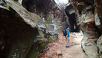 NWA Democrat-Gazette/FLIP PUTTHOFF<br />Rocky wonder is eveywhere for Gene Williams Dec. 22 2018 during a hike along the Alum Cove trail. Natural bridges, crevice caves and forest are seen during a 1.1-mile hike through the area.