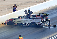 May 22, 2016; Topeka, KS, USA; NHRA funny car driver Tim Wilkerson climbs from the emergency roof escape hatch after crashing during the Kansas Nationals at Heartland Park Topeka. Wilkerson was uninjured in the accident. Mandatory Credit: Mark J. Rebilas-USA TODAY Sports