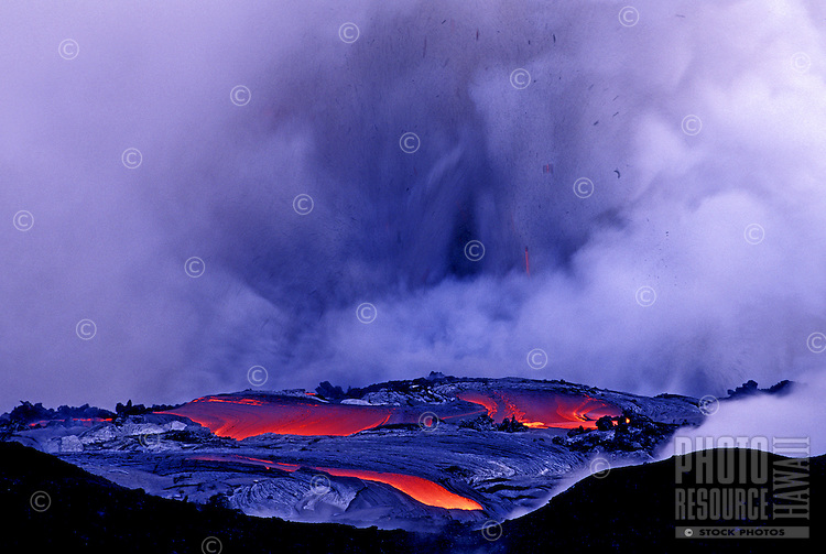Pools of lava head to the ocean emitting huge plumes of steam at Volcanoes National park on the Big Island of Hawaii.