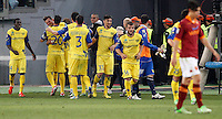 Calcio, Serie A: Roma vs Chievo Verona. Roma, stadio Olimpico, 7 maggio 2013..ChievoVerona forward Cyril Thereau, of France, second from left, celebrates with teammates after scoring the winning goal during the Italian Serie A football match between AS Roma and ChievoVerona at Rome's Olympic stadium, 7 May 2013. ChievoVerona won 1-0..UPDATE IMAGES PRESS/Riccardo De Luca