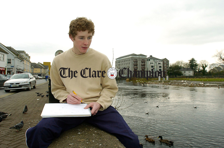 Artist Cillian Boyd at work on his sketchpad at Woodquay in Ennis. Photograph by John Kelly.