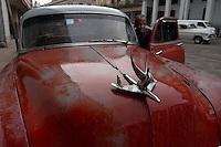 red oldtimer, american car in Havana, Cuba