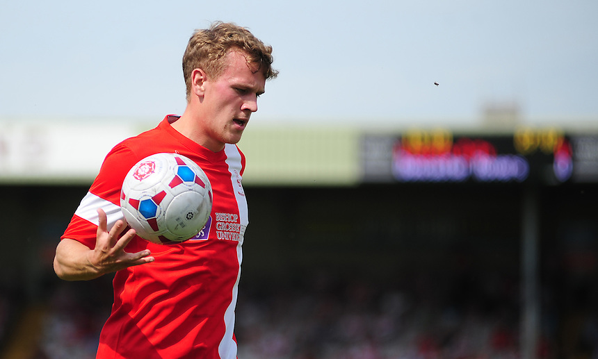 Lincoln City's Tom Miller <br /> <br /> Photographer Chris Vaughan/CameraSport<br /> <br /> Football - Friendly - Lincoln City v Doncaster Rovers - Saturday 12th July 2014 - Sincil Bank Stadium - Lincoln<br /> <br /> &copy; CameraSport - 43 Linden Ave. Countesthorpe. Leicester. England. LE8 5PG - Tel: +44 (0) 116 277 4147 - admin@camerasport.com - www.camerasport.com