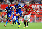 Daley Blind of Manchester United and Islam Slimani of Leicester City  during the Premier League match at Old Trafford Stadium, Manchester. Picture date: September 24th, 2016. Pic Sportimage