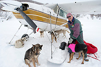 Volunteer Pilot Bruce Morony readies to load a number of dropped dogs at Takotna for a flight back to  McGrath during Iditarod 2009