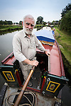 "© Joel Goodman - 07973 332324 . 23 August 2013 . Barge on Bridgewater Canal , moored in Oughtrington , Cheshire , UK . Gallery curator DAVE CLARKE (67) and his wife FREDA CLARKE (68) (both from Altrincham) (both correct) on a barge which they have bought and adapted to form a floating art gallery called "" Artism "" , exhibiting the work of autistic artists . Photo credit : Joel Goodman"