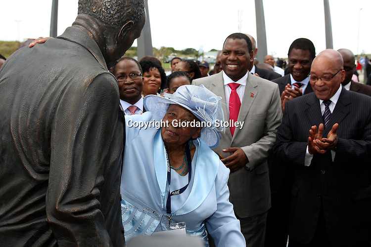 DURBAN - 8 March 2012 - Lulu Dube admires a statue of her father John Dube which was unveiled at the official opening of the Dube TradePort by President Jacob Zuma. .Dube was the founding president of the ruling African National Congress.  Looking on from left are transport minister Sbu Ndebele, KwaZulu-Natal Premier Zweli Mkhize, Artcs and Culture minister Paul Mashatile and Zuma..Picture: Giordano Stolley