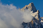 Cloud streaming off Teewinot mountain peak, Grand Teton National Park, Wyoming