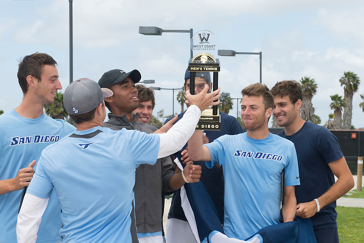 April 26, 2014; San Diego, CA, USA; San Diego Toreros player Clarke Spinosa, Uros Petronijevic, Filip Vittek, Romain Kalaydjian, Ciaran Fitzgerald, Andrew Raphaelson, Geoffrey Fosso, Aaron Addison, men's tennis head coach Brett Masi, and assistant coach Matt Brooklyn pose with the championship trophy during the finals of the WCC Tennis Championships at Barnes Tennis Center.