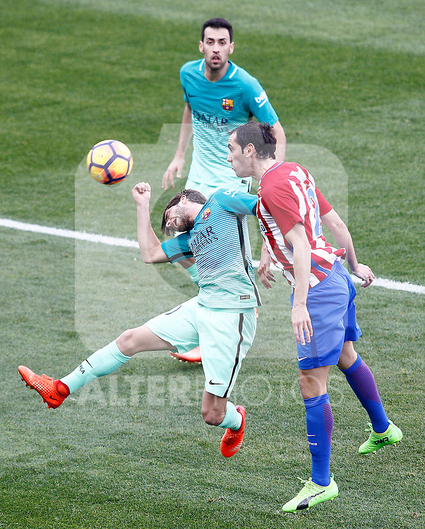 Atletico de Madrid's Diego Godin (r) and FC Barcelona's Sergi Roberto (l) and Sergio Busquets during La Liga match. February 26,2017. (ALTERPHOTOS/Acero)