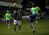 9th February 2018, The Den, London, England; EFL Championship football, Millwall versus Cardiff City; Sol Bamba of Cardiff City clears the ball over Lee Gregory of Millwall