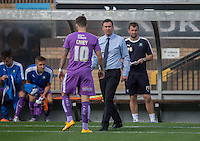 Graham Carey of Plymouth Argyle reports back to Derek Adams manager of Plymouth Argyle before kick off during the Sky Bet League 2 match between Wycombe Wanderers and Plymouth Argyle at Adams Park, High Wycombe, England on 12 September 2015. Photo by Andy Rowland.