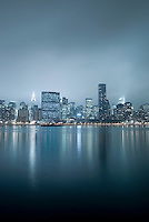 AVAILABLE FROM JEFF AS A FINE ART PRINT<br /> <br /> AVAILABLE FROM PLAINPICTURE FOR COMMERCIAL AND EDITORIAL LICENSING.  Please go to www.plainpicture.com and search for image # p5690078.<br /> <br /> Midtown Manhattan Skyline (East Side) at Night with Ominous Storm Clouds.  Prominent Buildings visible include the United Nations Headquarters, Chrysler Building, Citigroup Center (formerly Citicorp Center) and Trump World Tower
