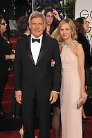 Harrison Ford &amp; Calista Flockhart at the 72nd Annual Golden Globe Awards at the Beverly Hilton Hotel, Beverly Hills.<br /> January 11, 2015  Beverly Hills, CA<br /> Picture: Paul Smith / Featureflash