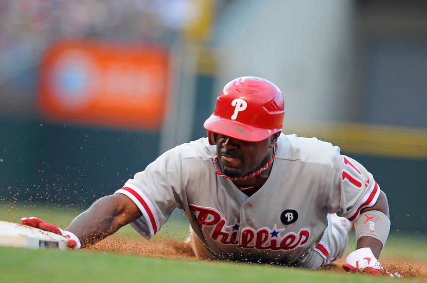 01 AUGUST 2011:    Philadelphia Phillies shortstop Jimmy Rollins (11) dives back to first base to avoid a pickoff  during a regular season game between the Philadelphia Phillies and the Colorado Rockies at Coors Field in Denver, Colorado. The Phillies beat the Rockies 4-3 in 10 innings. *****For Editorial Use Only*****