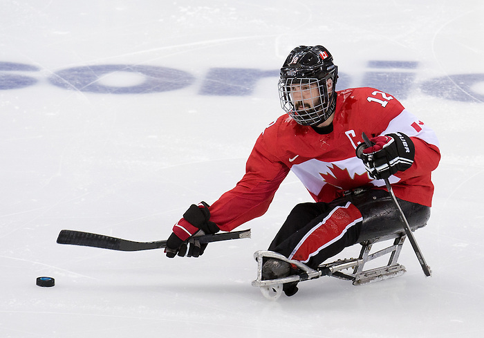 Sochi, RUSSIA - Mar 13 2014 - Greg Westlake as Canada takes on USA in Sledge Hockey Semi-Final at the 2014 Paralympic Winter Games in Sochi, Russia.  (Photo: Matthew Murnaghan/Canadian Paralympic Committee)