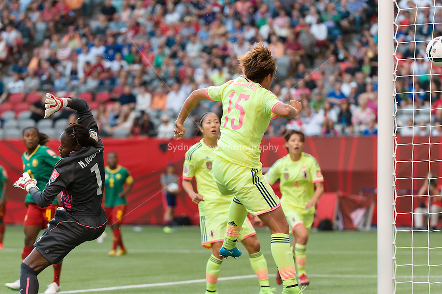 June 12, 2015: Yuika SUGASAWA of Japan heads the ball and scores during a Group C match at the FIFA Women's World Cup Canada 2015 between Cameroon and Japan at BC Place Stadium on 12 June 2015 in Vancouver, Canada. Japan won 2-1. Sydney Low/AsteriskImages