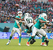 04.10.2015. Wembley Stadium, London, England. NFL International Series. Miami Dolphins versus New York Jets. Miami Dolphins Quarterback Ryan Tannehill throws the ball down field before being tackled by New York Jets Outside Linebacker Calvin Pace.