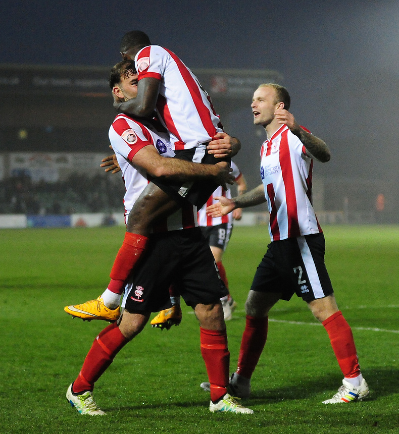 Lincoln City&rsquo;s Theo Robinson celebrates scoring the opening goal with Lincoln City's Matt Rhead and Bradley Wood<br /> <br /> Photographer Andrew Vaughan/CameraSport<br /> <br /> Vanarama National League - Lincoln City v Maidstone - Saturday 26th November 2016 - Sincil Bank - Lincoln<br /> <br /> World Copyright &copy; 2016 CameraSport. All rights reserved. 43 Linden Ave. Countesthorpe. Leicester. England. LE8 5PG - Tel: +44 (0) 116 277 4147 - admin@camerasport.com - www.camerasport.com