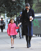 Katie Holmes holds her daughter Suri's hand on their way to school _ New York