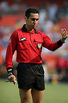3 July 2004: Referee Jair Marrufo signals to MetroStars midfielder Ricardo Clark (not pictured) before issuing him a yellow card in the second minute of the game. DC United defeated the MetroStars 6-2 at RFK Stadium in Washington, DC during a regular season Major League Soccer game..