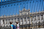 A couple of tourists in front of the `Palacio Real de Madrid´ Madrid´s Royal Palace in Madrid, Spain. Today, King Juan Carlos of Spain made a public announcement of his abdication will, his son, Prince Felipe of Spain, will become Spain´s king after the official ceremony. June 02, 2013. (ALTERPHOTOS/Victor Blanco)