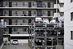 Multi-level vertical lift parking lot three stories high by an apartment building in Kyoto, Japan 2017