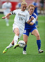 Oregon's Kelsey Jahn fights for the ball with Green Bay Southwest's Katie Rolefson, as Oregon tops Green Bay Southwest 3-0 to win the WIAA Division 2 girls soccer state championship, on Saturday, June 20, 2015 at Uihlein Soccer Park in Milwaukee, Wisconsin