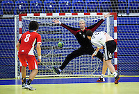 11 JUN 2010 - LONDON, GBR - Great Britain goalkeeper Jesper Parker is unable to save a shot from Estonia's Mait Patrail during the two teams 2012 European Handball Championships Qualification Tournament match (PHOTO (C) NIGEL FARROW)
