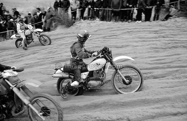 Enduro du Touquet 1987. Honda XL 500 S. Dirt bike beach race at Le Touquet, Normandy, France. --- No releases available, but releases may not be necessary for certain uses. Automotive trademarks are the property of the trademark holder, authorization may be needed for some uses. --- Info: A thousand motorcycles take part in this mad event. The race starts along the beach, followed by a run into the sand dunes. The entry point in the dunes is most spectacular: All motorbikes have to pass through a small opening in the dunes. Once the fast professional drivers have flown through, this first passage developes into a true bottleneck with many hundreds of motorbikers trying to get through at the same time. Motorcycles are strewn all over the place. Many have fallen, others have already broken down. In the meantime, the professional riders are progressing quickly. But their riding style changes from racing full-out as soon as they are approaching the lappers from behind. Outmaneuvering them at high speeds is an art form! After three hours it's all over.....