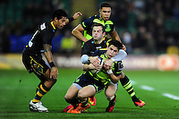 Joey Carbery of Leinster Rugby is tackled to ground by Stephen Myler of Northampton Saints. European Rugby Champions Cup match, between Northampton Saints and Leinster Rugby on December 9, 2016 at Franklin's Gardens in Northampton, England. Photo by: Patrick Khachfe / JMP