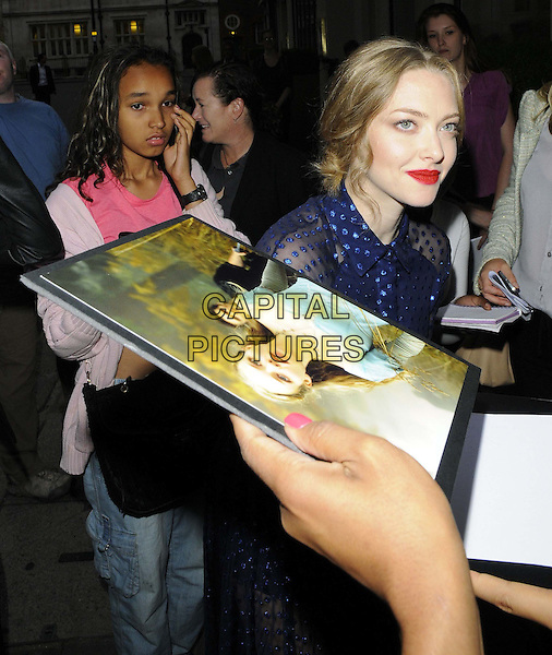 Amanda Seyfried<br /> 'Lovelace' special screening at the Mayfair Hotel, London, England.<br /> 12th August 2013<br /> half length blue dress sheer red lipstick fans signing autographs   <br /> CAP/CAN<br /> &copy;Can Nguyen/Capital Pictures