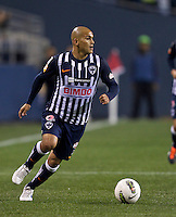 Humberto Suazo of CF Monterrey looks to pass the ball during a CONCACAF Champions League match against the Seattle Sounders FC at CenturyLink Field in Seattle Tuesday Oct. 18, 2011. CF Monterrey won the game 2-1.