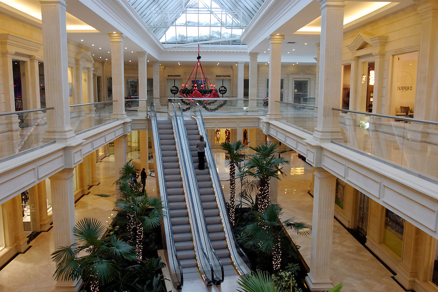 Moscow, Russia, 04/01/2004..Customers and staff at the luxurious but largely deserted Crocus City shopping mall.