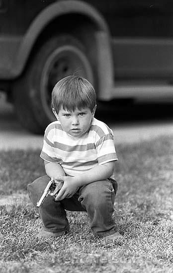 Kid and gun.<br />
