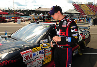 Aug. 7, 2009; Watkins Glen, NY, USA; NASCAR Sprint Cup Series driver Denny Hamlin after making his lap during qualifying for the Heluva Good at the Glen. Mandatory Credit: Mark J. Rebilas-