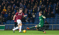 James Collins of Northampton Town takes the ball around Goalkeeper Benjamin Buchel of Oxford United during the Sky Bet League 2 match between Oxford United and Northampton Town at the Kassam Stadium, Oxford, England on 16 February 2016. Photo by Andy Rowland.
