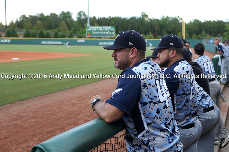 31 May 2016: Nova Southeastern head coach Greg Brown (left) with Brandon Gomez (24). The Nova Southeastern University Sharks played the Lander University Bearcats in Game 8 of the 2016 NCAA Division II College World Series  at Coleman Field at the USA Baseball National Training Complex in Cary, North Carolina. Nova Southeastern won the game 12-1.
