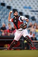 Nashville Sounds catcher Matt Pagnozzi (10) throws to first to complete the strike out during a game against the Omaha Storm Chasers on May 19, 2014 at Herschel Greer Stadium in Nashville, Tennessee.  Nashville defeated Omaha 5-4.  (Mike Janes/Four Seam Images)