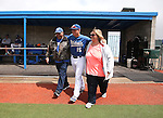Wildcats' Jake Bennett takes the field with his parents during Sophomore Day ceremonies at Western Nevada College in Carson City, Nev., on Saturday, April 25, 2015. <br /> Photo by Cathleen Allison
