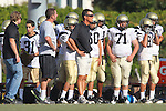 Beverly Hills, CA 09/23/11 - Coach Esparza, \p71\, Ron Niederman (Peninsula #60), Brandon Wilson (Peninsula #81) in action during the Peninsula-Beverly Hills frosh football game at Beverly Hills High School.