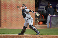 Campbell Camels catcher Zach Minnick (20) makes a throw to first base against the High Point Panthers at Williard Stadium on March 16, 2019 in  Winston-Salem, North Carolina. The Camels defeated the Panthers 13-8. (Brian Westerholt/Four Seam Images)