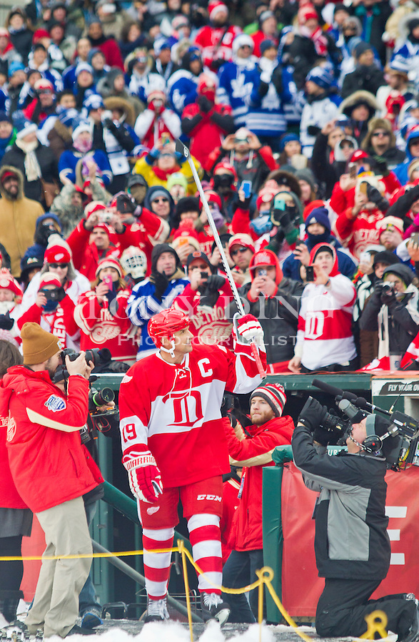 31 December 2013: Former Detroit Red Wings forward and former captain Steve Yzerman (19) waves to fans with his stick during player introductions before the Toronto Maple Leafs v Detroit Red Wings Alumni Showdown hockey game, at Comerica Park, in Detroit, MI.