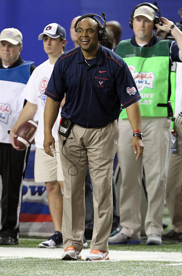 ATLANTA, GA - DECEMBER 31:  Head coach Mike London of the Virginia Cavaliers coaches his team during the 2011 Chick Fil-A Bowl against the Auburn Tigers at the Georgia Dome on December 31, 2011 in Atlanta, Georgia. Auburn defeated Virginia 43-24. (Photo by Andrew Shurtleff/Getty Images) *** Local Caption *** Mike London