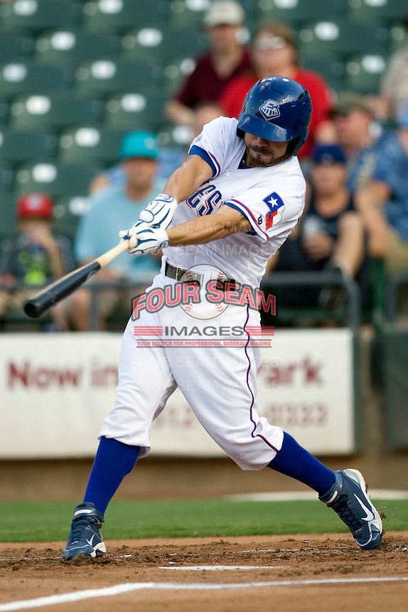 Round Rock Express shortstop Omar Qunitanilla #3 swings during a game against the Memphis Redbirds at the Dell Diamond on July 7, 2011in Round Rock, Texas.  Round Rock defeated Memphis 6-4.  (Andrew Woolley / Four Seam Images)
