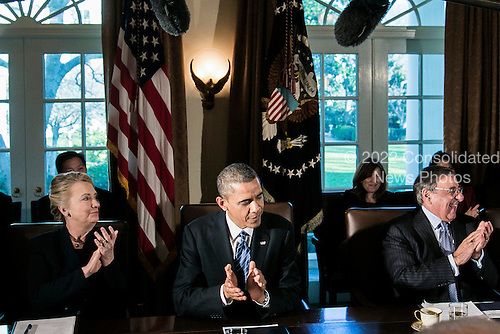 United States President Barack Obama, center, Secretary of Defense Leon E. Panetta, right, and Secretary of State Hillary Rodham Clinton, left, applaud after the president announced a few upcoming birthdays at a cabinet meeting at the White House on November 28, 2012 in Washington, D.C. The president met yesterday with small business owners and today with the chief executives of major corporations in ongoing talks about the looming fiscal cliff..Credit: T.J. Kirkpatrick / Pool via CNP