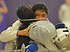 Shannon Sarker of Great Neck North (face visible) congratulates opponent Elin Hu of Manhasset after their Nassau County girls' fencing saber championship bout at Oyster Bay High School on Saturday, Jan. 30, 2016. Hu defeated Sarker 15-12 to claim the county title.