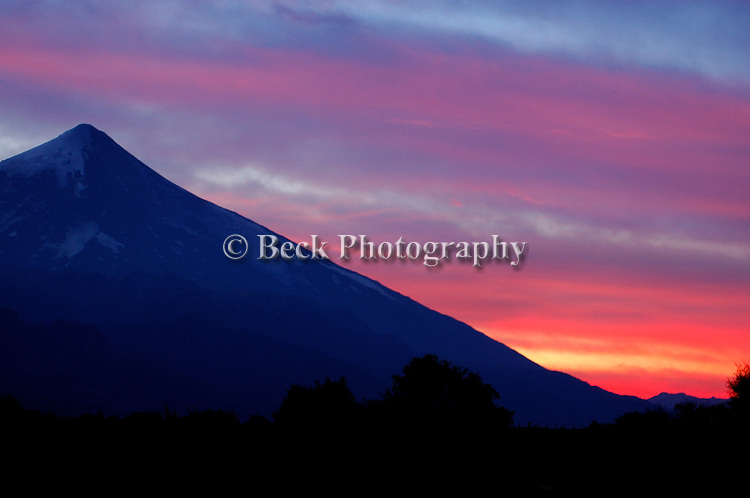 The Lanin Volcano at sunset on the Rio Malleo, Argentina.
